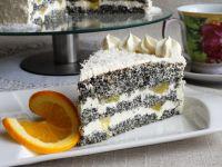 Tort makowo-pomarańczowy - Tort posypać wiórkami kokosowymi i udekorować pomarańczą