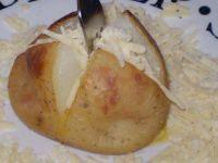 Ziemniaki pieczone z masłem i serem :