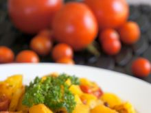 Pieczona dynia z pomidorkami