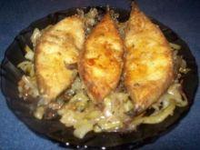 Sandacz z cebulą i suszonymi grzybami